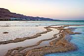 Salt deposits in the Dead Sea at sunset, Ein Bokek, Southern District, Israel
