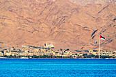 View of Jordanian flag and buildings in Aqaba, Red Sea Coast, Jordan