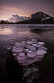 Beautiful natural scenery with frozen Vermilion Lakes at night, Banff National Park, Alberta, Canada