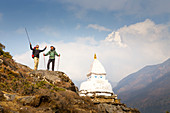 Two happy hikers near a Buddhist Stupa and with Ama Dablam mountain in the background. The trek to Everest Base Camp (EBC) is possibly the most dramatic and picturesque in the Nepalese Himalaya. Not only will you stand face to face with Mount Everest, Sagarmatha in Nepali language, at 8,848 m (29,029 ft), but you will be following in the footsteps of great mountaineers like Edmund Hillary and Tenzing Norgay. The trek is scenic and offers ever-changing Himalayan scenery through forests, hills and quaint villages. A great sense of anticipation builds as you trek up the Khumbu Valley, passing thr