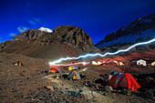 A headlamp illuminates a trail at Plaza de Argentina Base Camp beneath Aconcagua, one of the Seven Summits and the highest peak in the Western Hemisphere, Mendoza, Argentina