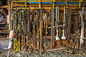 Chains and farming equipment hanging in barn, Grass Valley, Oregon, USA