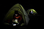 Backpackers use headlamps at night while camping near Thousand Island Lake on trek of Sierra High Route in Minarets Wilderness, Inyo National Forest, California, USA