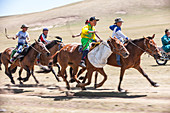 Kids aged 6-12, compete for 20 kilometers bareback horse race at Annual Naadam Festival in Bunkhan, Mongolia