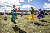 Dance performers dancing at Naadam Festival, Bulgan, Mongolia