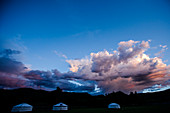 Huge clouds hovering above Mongolian yurt (ger) camp at Lapis Sky Camp, Bunkhan Valley, Bulgam, Mongolia