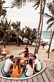 People enjoying beach at Papaya Playa Resort in Tulum, Mexico
