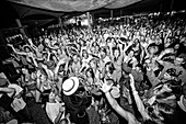 Reggae band performance and audience at music festival, San Bernardino County, California, USA