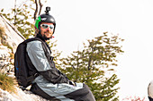 Male base jumper relaxing on rocks before jumping, Brento, Venetien, Italy