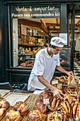 Bread sale in front of the deli Paul in Aix en Provence, France