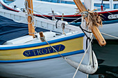Small wooden boat with ST Tropez lettering in the port of St. Tropez, Var, Cote d'Azur, South of France, France, Europe, Mediterranean Sea, Europe