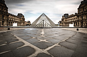 Courtyard of the Louvre with a view of the glass pyramid after the rain, Paris, Île-de-france, France