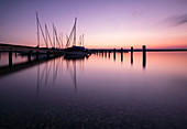 Pier with sailing boats at sunset at Ammersee, long exposure, Ammersee, Alpine foothills, Bavaria, Germany
