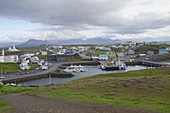 Small Village and Harbor with Mountains in Background on Cloudy Day, Stykkishólmur, Iceland