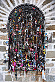 Lucky charm attached to the lattice to a small Madonna shrine, Chapel Pragser Wildsee, Lago di Braies, Braies, South Tyrol, Italy