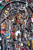 Lucky charm attached to the lattice to a small Madonna shrine, The Madonna statue is made of wood, chapel Pragser Wildsee, Lago di Braies, Prague, South Tyrol, Italy