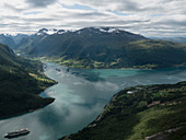 Scenic view idyllic green cliffs and fjord, Olden, Norway