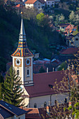 Church with clock tower in Brasov, Romania