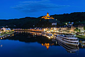 Town and Cochem Imperial Castle by river at sunset in Cochem, Germany