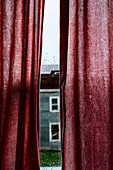 Red curtains over window