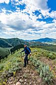 Smiling senior man hiking in Sun Valley, Idaho, USA