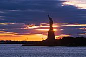 Statue of Liberty at Sunset, Manhattan, New York, USA