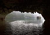 Chinese Junk Seen Through a Cave Entrance,Halong Bay, Quang Ninh, Vietnam
