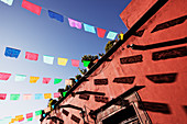 Multicolor banners against blue sky, San Miguel de Allende, Guanajuato, Mexico