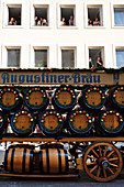 Augustiner team with beer kegs at the entrance of the Oktoberfest farmers to the Oktoberfest, Munich, Bavaria, Germany