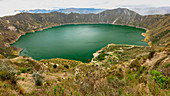 View of the turquoise crater lake Quilotoa in Ecuador