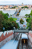 View of the Chain Bridge of Budapest, Hungary, from Castle Hill with the cable car below