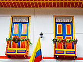 House painted in the colors of the Colombian flag (center), Filandia, Coffee Region, Colombia, South America