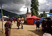 People at a fair on dirt road, feast at Gangteng Monastery, Phobjikha Valley, Bhutan, Himalayas, Asia