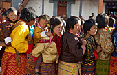 Women stand for blessing serpent, mask dance, festival at Gangteng Monastery, Phobjikha Valley, Bhutan, Himalayas, Asia