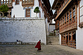 Trongsa Dzong, a monk in the courtyard, Bhutan, Himalayas, Asia