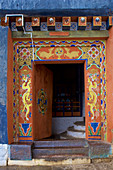 Colorful entrance gate to Jakar Dzong in Chamkhar Valley, Bumthang, Bhutan, Himalayas, Asia