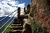 Stairs to the monastery Taktshang or Taktsang or Tigernest in a rock wall, Buddhist monastery in the Parotal, Bhutan, Himalayas, Asia