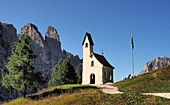 at the Gardena Pass Chapel with Sella, Dolomites, South Tyrol, Italy