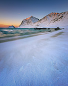 Snow covered Haukland Beach at sunset, Lofoten Islands, Nordland, Norway, Europe