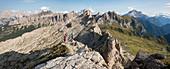 Hiking in typical mountainous terrain of the Dolomites range of the Alps on the Alta Via 1 trekking route near Rifugio Nuvolau, Belluno, Veneto, Italy, Europe