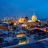 View over Old Town towards San Pedro Claver Church and Bocagrande at dusk, Cartagena, Bolivar Department, Colombia, South America