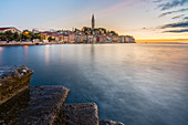 The old town at sunset, in summer, with stone steps in the foreground, Rovinj, Istria county, Croatia, Europe