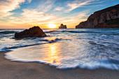 Waves at sunset on the Beach of Masua, Iglesias, Sud Sardegna province, Sardinia, Italy, Mediterranean, Europe
