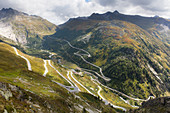 Twisting roads of the Furka and Grimsel Alpine Passes meet at the hamlet of Gletsch, Canton of Valais, Switzerland, Europe