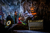 Asian girls lighting incense in temple, Myanmar