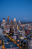 Aerial view of Seattle skyline lit up at night, Washington, United States