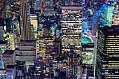 Aerial view of highrise buildings in cityscape at twilight, USA
