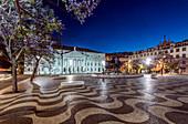 Rossio Square illuminated at night, Lisbon, Portugal