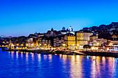 Porto cityscape and harbor illuminated at night, Porto, Portugal