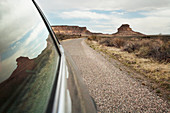 Close up of car window driving through desert landscape, Chaco Canyon, New Mexico, United States